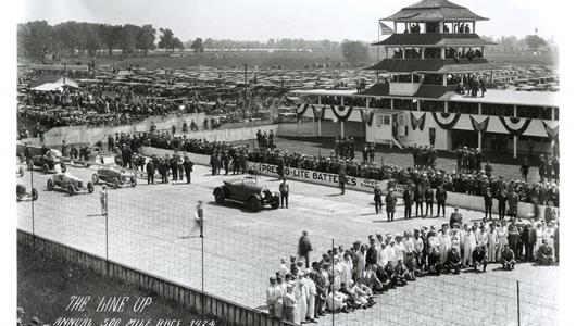 Drivers, crew members and race officials pose on the main straight for the pre-race group photo at the Indianapolis Motor Speedway before the start of the 1924 Indianapolis 500.