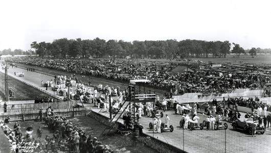 The starting field and Marmon Pace Car on the track at the Indianapolis Motor Speedway  before the start of the 1928 Indianapolis 500.