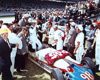 Parnelli Jones with car owner J.C. Agajanian and crew in Victory Circle after winning the 1963 Indianapolis 500 at the Indianapolis Motor Speedway.
