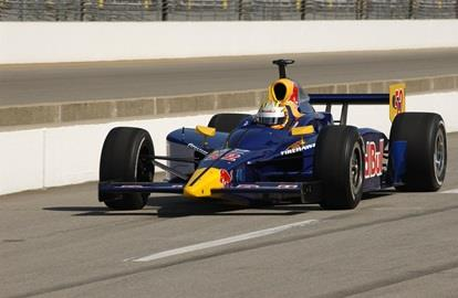 Ed Carpenter in the #52 Red Bull Cheever Racing Dallara Chevrolet coming down pit lane at Indianapolis Motor Speedway during the Rookie Orientation Program.