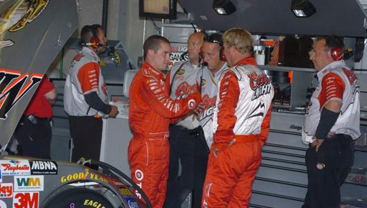 Sterling Marlin and Casey Mears of Chip Ganassi Racing in the garage area of the Indianapolis Motor Speedway.