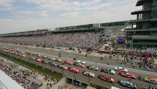 Former Brickyard 400 pace cars pass by starting grid.