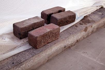 Some of the original bricks from 1909 used to reinstall the Yard of Bricks.