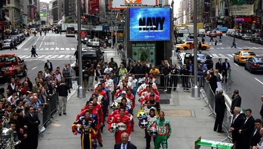 The starting field for the 89th running of the Indianapolis 500, lines up in Times Square in New York City.