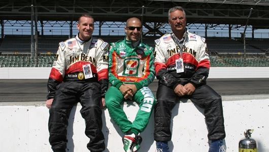 Tony Kanaan and a couple of participants getting ready for the Indy Experience 2 seater rides at the Indianapolis Motor Speedway.