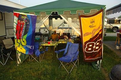 A fan relaxes at his campsite early on race day morning.