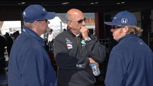 Buddy Rice, right, meets with team co-owner Bobby Rahal.