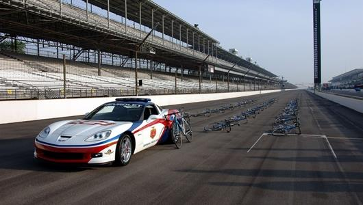 The 2006 Chevrolet Corvette Z06 pace car and the field of 33 Trek Discovery Channel Indy 500 road bikes. Each bike is signed by a driver and Lance Armstrong.