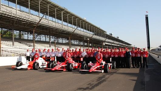 Indianapolis 500 Front Row, Ryan Briscoe, Dan Wheldon and Scott Dixon, pose for pictures with their crews during a photo shoot.