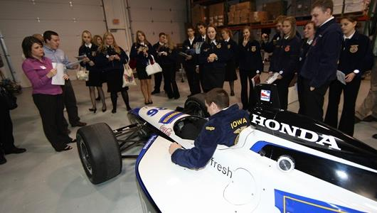 FFA members sat in the cockpit of an IndyCar Series car during their tour of Indy Racing League headquarters Oct. 23.