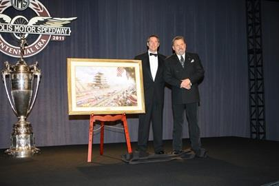IMS CEO Tony George, left, and famed painter Thomas Kinkade after Kinkade unveiled his Studio Masterwork that will serve as the cover of the 2009 Indianapolis 500 Official Program.