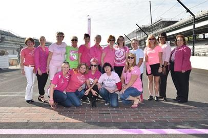 Breast cancer survivors along with Verizon IndyCar Series driver Pippa Mann, Susan G. Komen Central Indiana Leadership and IMS President Doug Boles celebrate National Breast Cancer Awareness Month at the Indianapolis Motor Speedway by painting the starting line pink