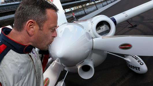 Winner of the RBAR Master Class event, Matthias Dolderer kisses his plane on the IMS track