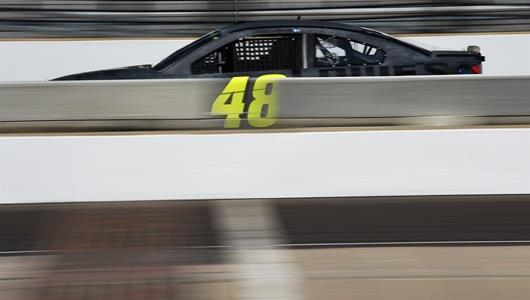 Jimmie Johnson crosses the Yard of Bricks during a tire test at IMS