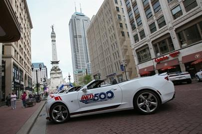 500 Festival cars branded with Indianapolis 500 logos line the streets of Downtown Indianapolis to kick off May.