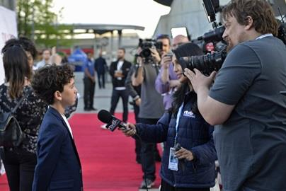 Jason Drucker talks with media on the red carpet for the Diary of a Wimpy Kid special red carpet screening at the Indianapolis Motor Speedway