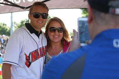 Max Chilton takes pictures with some fans after throwing the first pitch at an Indianapolis Indians baseball game.
