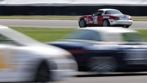 Cars chase the leader during Qualifying Day One of the SCCA Runoffs at the Indianapolis Motor Speedway