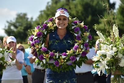 Lexi Thompson wears the championship wreath after she wins the LPGA Indy Women in Tech Championship at Brickyard Crossing