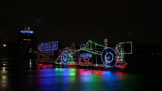 A holiday light racecar at IMS Lights at the Brickyard
