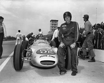 Dan Gurney with his number 52 car in 1962
