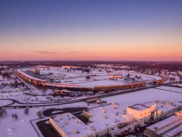 Aerial shot of the Indianapolis Motor Speedway at sunset after a snowfall