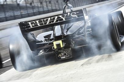 Jordan King peels out of his pit stall during the manufacturers test at the Indianapolis Motor Speedway