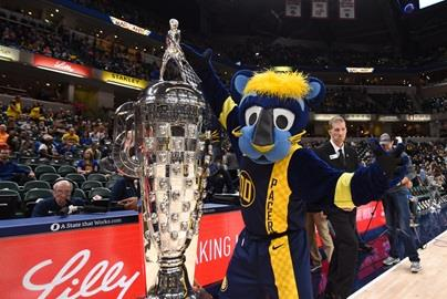 Indiana Pacers mascot, Boomer, hangs out courtside with the Borg-Warner Trophy at IMS Night