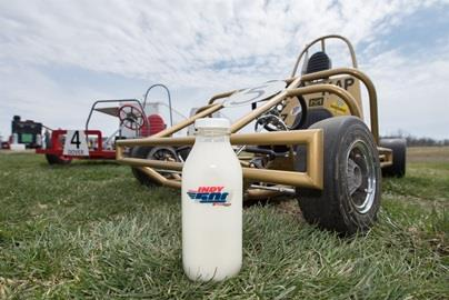 Indy 500 milk sits next to the Purdue Grand Prix carts before the race.