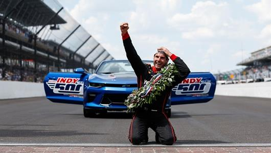 Will Power celebrates on the Yard of Bricks after winning the 102nd Indianapolis 500 at the Indianapolis Motor Speedway