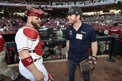Conor Daly talks to Reds' catcher Tucker Barnhart before throwing out the first pitch.