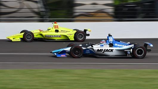 Simon Pagenaud and Takuma Sato set sail toward Turn 4 during practice for the 102nd Indianapolis 500 at the Indianapolis Motor Speedway