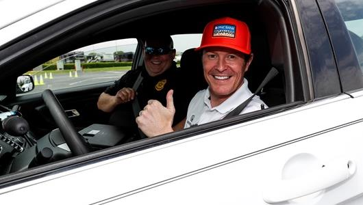 Sgt. Bob Hatch rode shotgun with Scott Dixon during his EVOC training.
