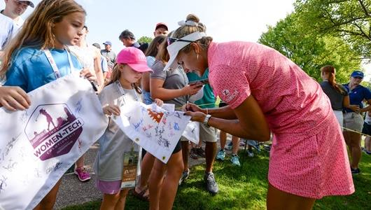 Lexi Thompson interacting with fans at the Indy Women in Tech Championship.