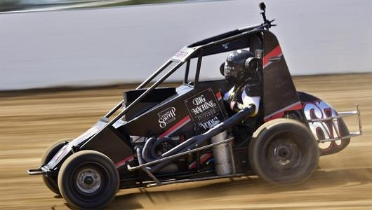 Sarah Fisher taking laps on the dirt track.