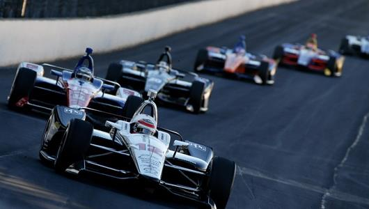 Will Power leads the train into Turn 1 during the tire and aero kit test at the Indianapolis Motor Speedway