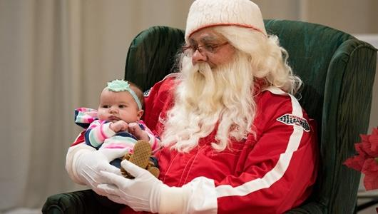 Future race fan meets with 'Speedway Santa' at the Indianapolis Motor Speedway