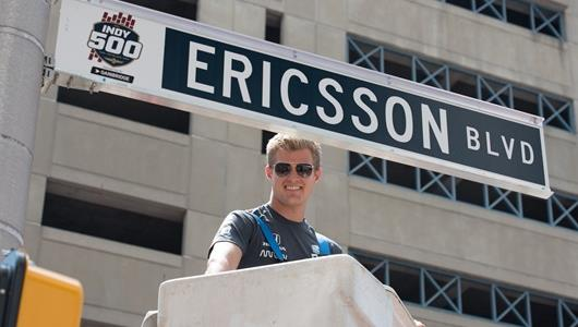 Indy 500 rookie driver Ericsson putting up his street sign.