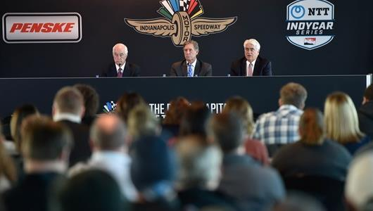 Roger Penske, Tony George and Mark Miles address the media at Indianapolis Motor Speedway