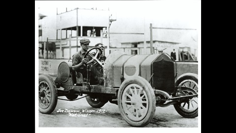 Joe Dawson in the #8 National  (National/National) at the Indianapolis Motor Speedway in 1912 .