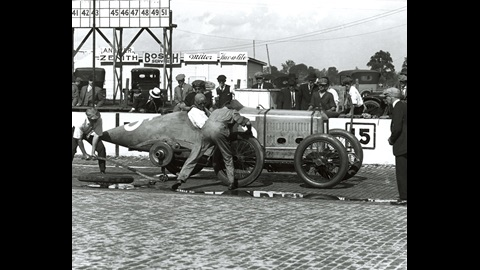 Barney Oldfield makes a pit stop during a practice session in his #15 Delage.