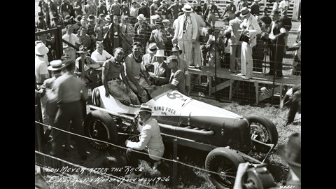 Despite the accumulation of fatigue and grime in the wake of a 500-mile race, Louis Meyer (in car, right) and his riding mechanic, Lawson Harris, are all smiles in Victory Lane following his 1936 Indianapolis 500 win.