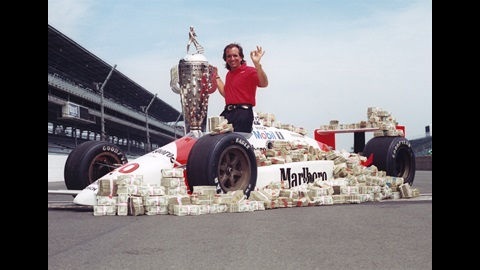 Emerson Fittipaldi celebrates his first of two Indianapolis 500 victories.