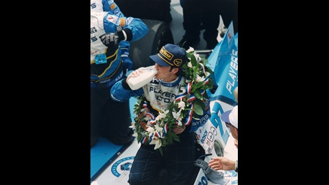 Jacques Villeneuve drinks milk in Victory Circle after winning the 1995 Indianapolis 500 at the Indianapolis Motor Speedway.