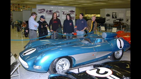 IMS historian Donald Davidson (left) leads rocks stars on a tour of Hall of Fame Museum.  L to R, Davidson, Brian Johnson (AC/DC), Jesse James Dupree (Jackyl), Rachel Bolan (Skid Row), Ralph Sheheen (Speed Channel) and Ralph Whitford (Aerosmith).