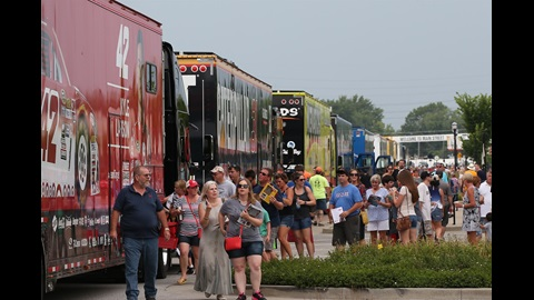 Fans enjoying the Hauler Parade on Main Street in Speedway to kick off the Crown Royal 400 at the Brickyard weekend