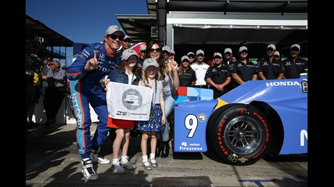Scott Dixon and family following his Pole day win.