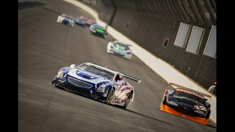 Cars round a turn during the Sunday session at the SCCA Runoffs at the Indianapolis Motor Speedway