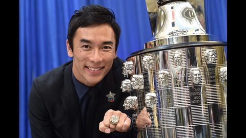 Takuma Sato with his winner's wring as his bas-relief sculpture is unveiled on the Borg-Warner Trophy as champion of the 101st Indianapolis 500
