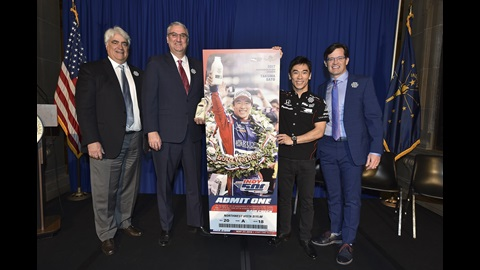 Mark Miles, Governor Holcomb, Takuma Sato and Doug Boles pose with the 2018 Indy 500 ticket